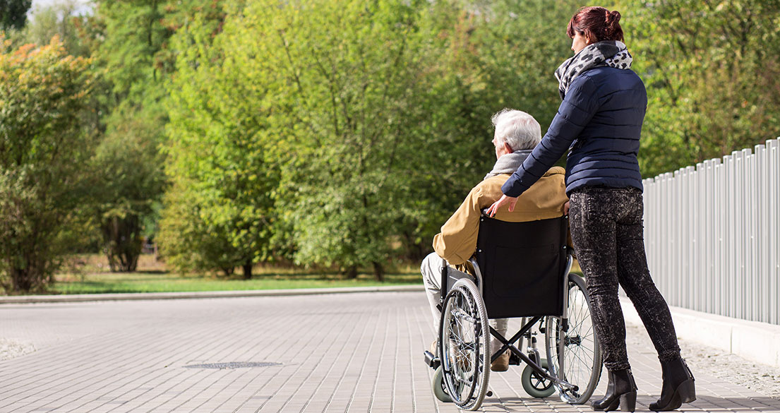 lady with WC and carer pushing chair